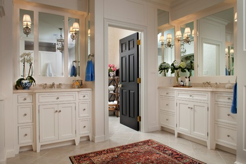 Interior Black painted door with White wood work and white bathroom cabinets.