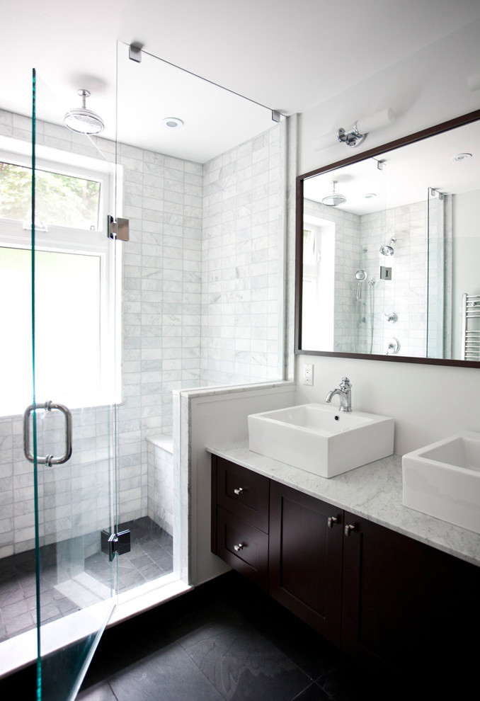 Shower bench - transitional marble tile shower bench idea in Toronto with marble countertops and a vessel sink
