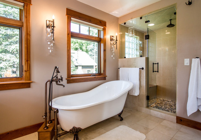 Clawfoot soaking tub with freestanding faucet and steam shower in ...