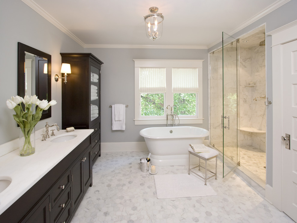 Large elegant master marble tile gray floor and marble floor bathroom photo in New York with white countertops, recessed-panel cabinets, black cabinets, blue walls, an undermount sink and a hinged shower door