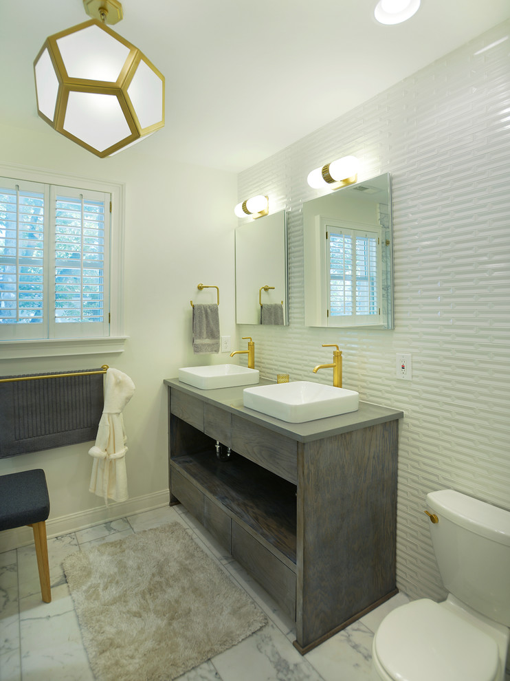 Inspiration for a transitional white tile bathroom remodel in Nashville with a vessel sink, flat-panel cabinets, gray cabinets, a two-piece toilet, white walls and gray countertops