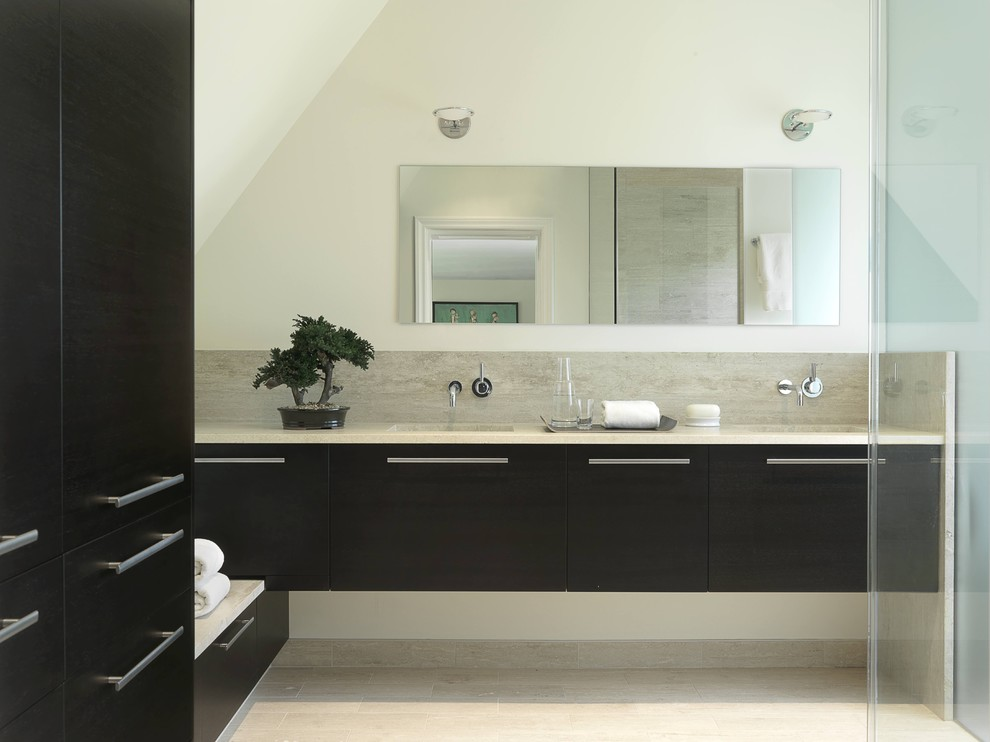 Inspiration for a mid-sized contemporary master black tile and porcelain tile porcelain tile walk-in shower remodel in St Louis with flat-panel cabinets, black cabinets, a one-piece toilet, marble countertops, white walls and an undermount sink
