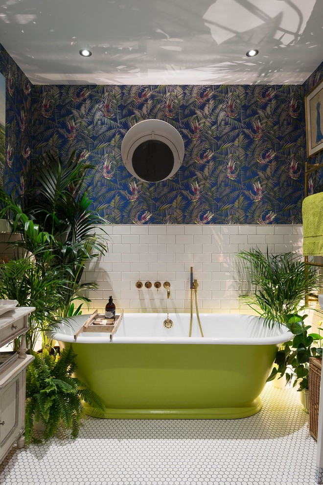 Eclectic master white tile and subway tile freestanding bathtub photo in London with multicolored walls