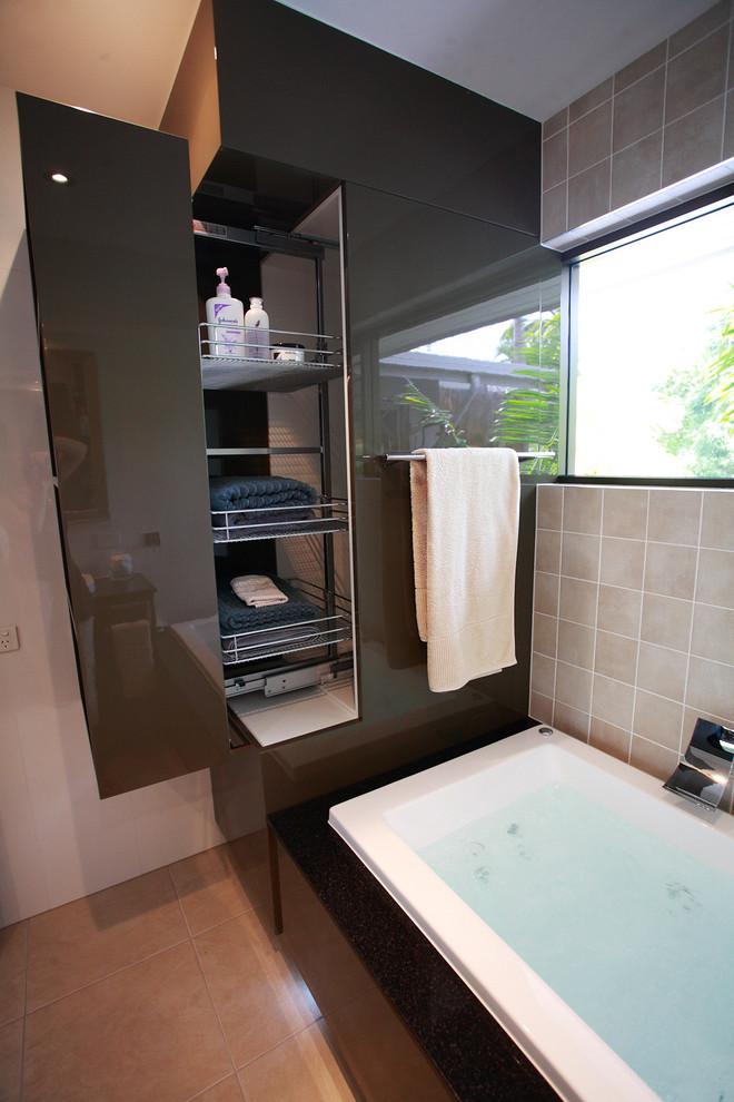 Drop-in bathtub - mid-sized modern beige tile travertine floor and beige floor drop-in bathtub idea in Brisbane with white walls