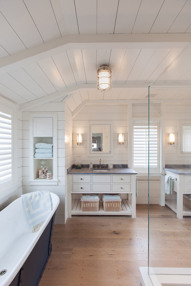 Example of a large beach style master white tile and ceramic tile light wood floor bathroom design in Boston with furniture-like cabinets, white cabinets, granite countertops, white walls and an undermount sink