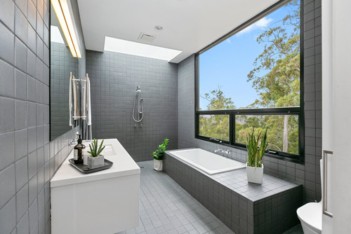 built in bath offers a ledge for storage
