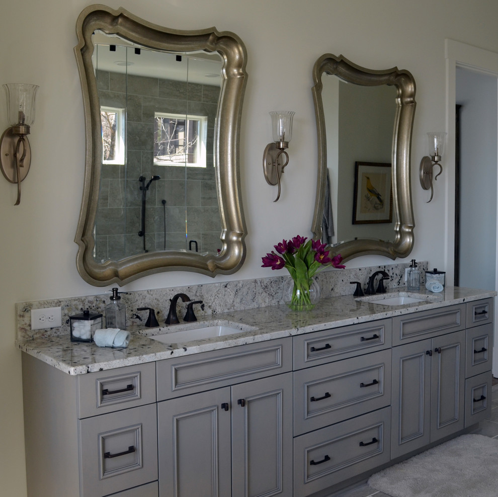 Inspiration for a mid-sized timeless master gray floor bathroom remodel in Other with beaded inset cabinets, gray cabinets, white walls, an undermount sink and granite countertops