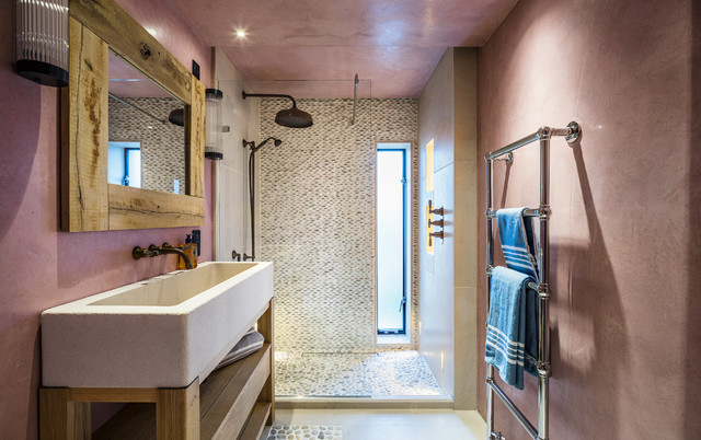 Bathroom - beach style 3/4 multicolored tile and mosaic tile pebble tile floor bathroom idea in Cheshire with open cabinets, light wood cabinets and pink walls