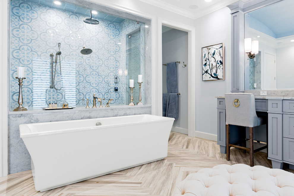 Inspiration for a mid-sized coastal master blue tile and ceramic tile porcelain tile and gray floor bathroom remodel in Tampa with shaker cabinets, gray cabinets, a two-piece toilet, blue walls, an undermount sink, marble countertops, a hinged shower door and gray countertops