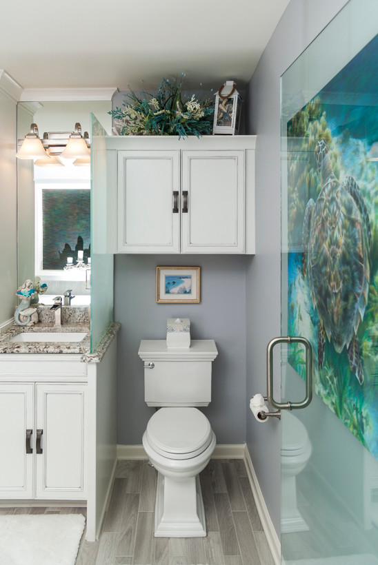 Inspiration for a small coastal master porcelain tile and gray floor drop-in bathtub remodel in Atlanta with recessed-panel cabinets, blue walls, an undermount sink and granite countertops
