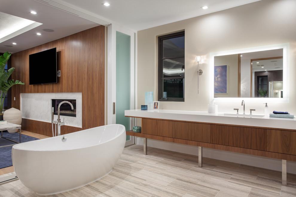 Ispirazione per un'ampia stanza da bagno padronale contemporanea con ante lisce, ante in legno scuro, vasca freestanding, pareti bianche, lavabo integrato, top in quarzo composito, pavimento multicolore e top bianco