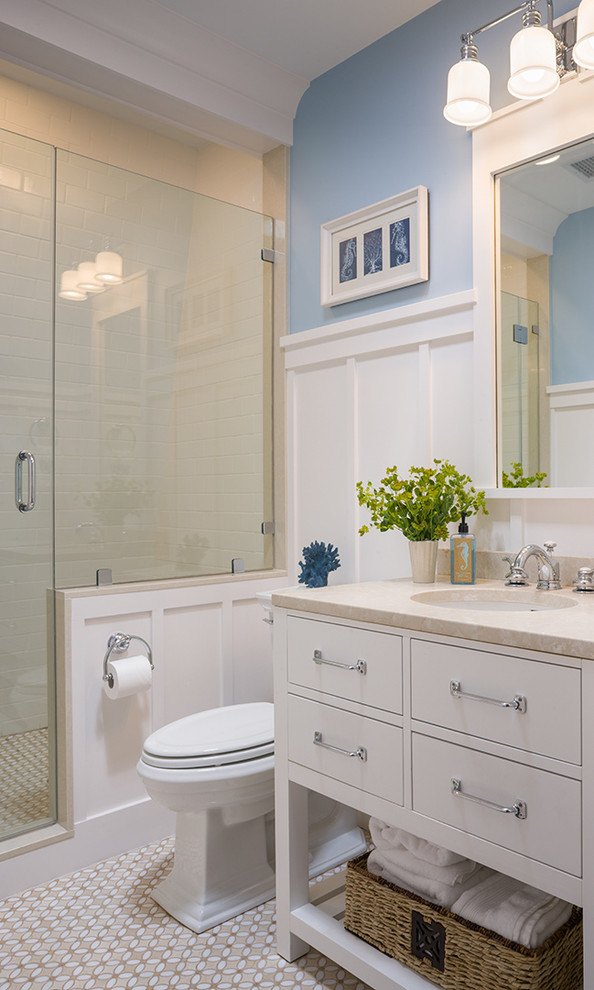 Inspiration for a victorian bathroom remodel in Providence with white cabinets and blue walls