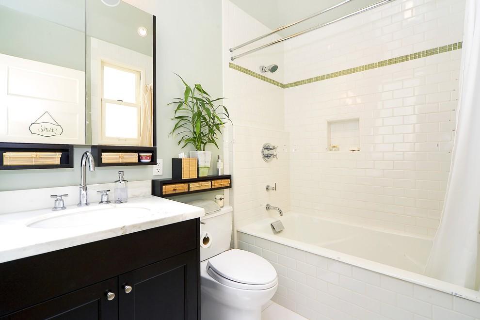 Elegant subway tile bathroom photo in San Francisco with black cabinets
