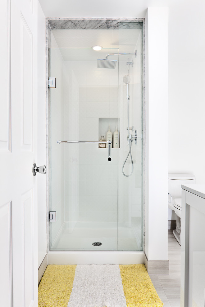 Mid-sized trendy white tile porcelain floor alcove shower photo in Toronto with white walls