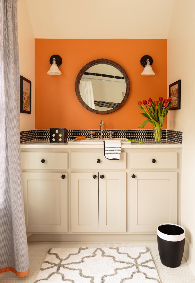 Inspiration for a mid-sized transitional kids' black tile ceramic tile and white floor bathroom remodel in Little Rock with shaker cabinets, white cabinets, orange walls, a drop-in sink and marble countertops