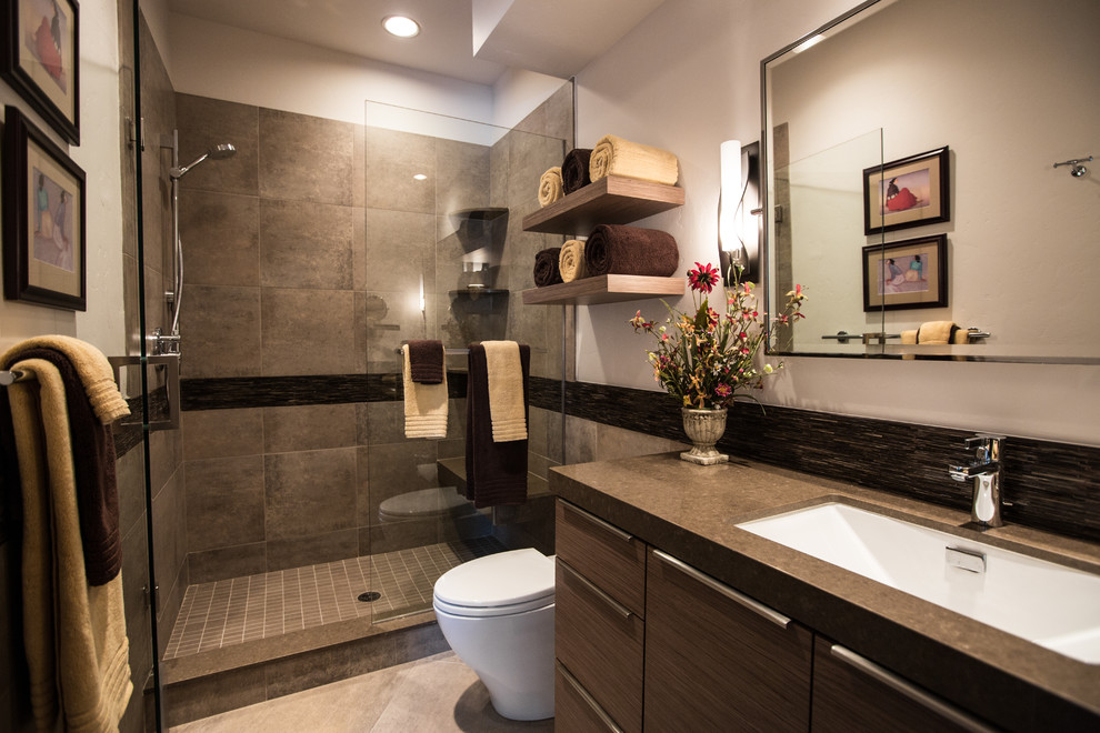 Example of a trendy porcelain tile bathroom design in Denver with an undermount sink and brown countertops