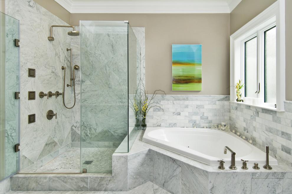 Inspiration for a transitional stone tile corner bathtub remodel in San Francisco