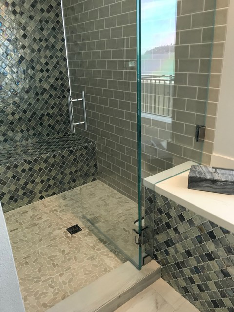 Example of a transitional multicolored tile and glass tile alcove shower design in San Francisco with white walls and a hinged shower door