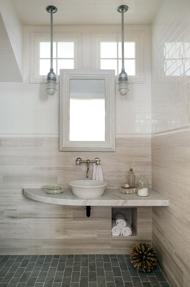 Example of a beach style beige tile bathroom design in Boston with a vessel sink and gray countertops
