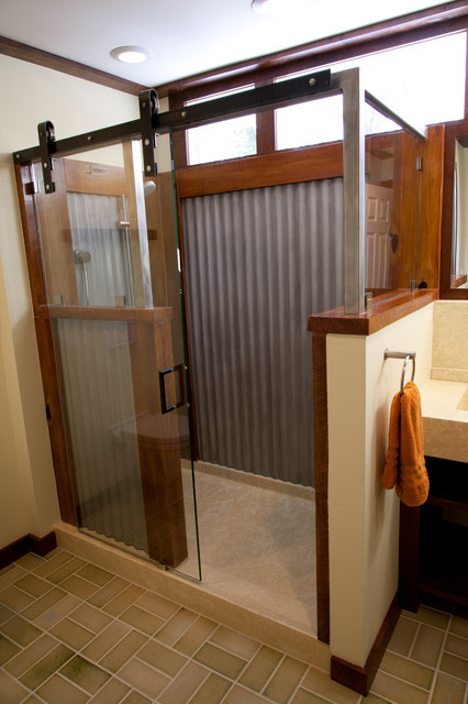 Concrete bathrooms farmhouse bathroom for Shower tub doors brass