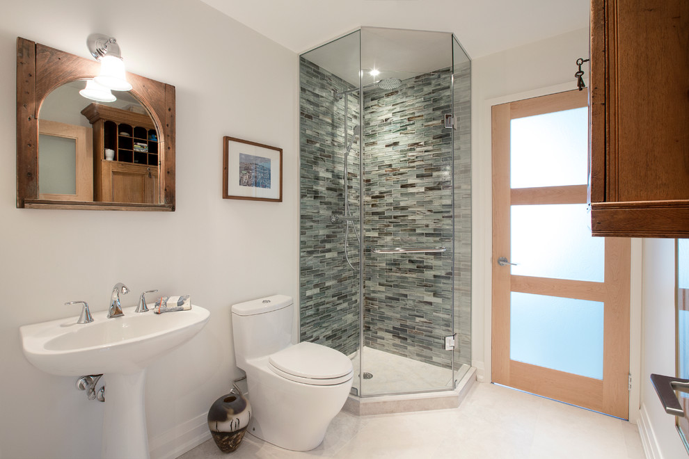 Corner shower - mid-sized transitional 3/4 multicolored tile and glass tile porcelain floor corner shower idea in Toronto with a pedestal sink, a one-piece toilet and white walls