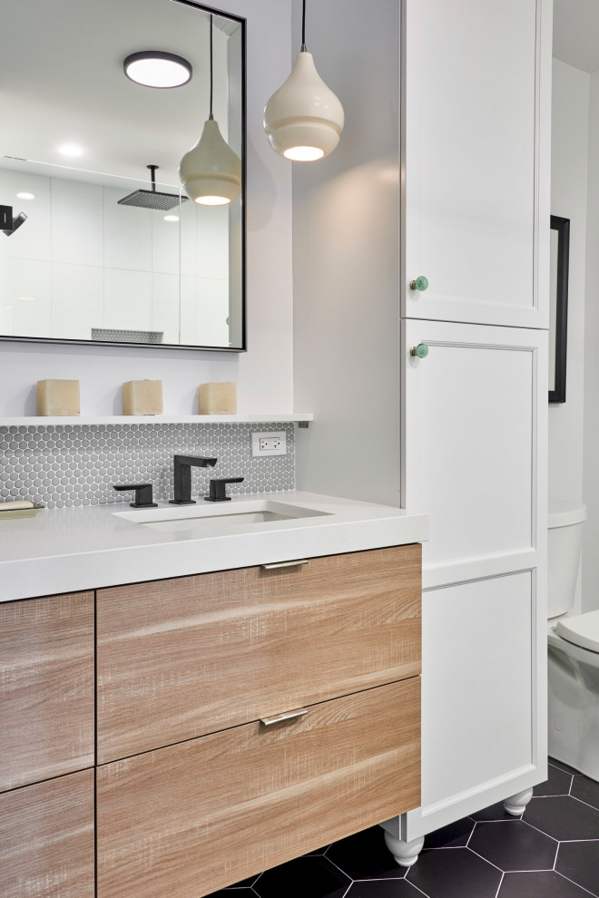 Small trendy master gray tile and mosaic tile ceramic tile, black floor and double-sink bathroom photo in Chicago with medium tone wood cabinets, a two-piece toilet, white walls, granite countertops, white countertops, flat-panel cabinets, an undermount sink and a floating vanity