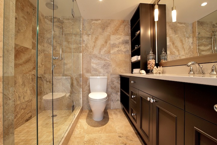 Inspiration for a small contemporary 3/4 beige tile and stone tile porcelain floor alcove shower remodel in Vancouver with shaker cabinets, an undermount sink, solid surface countertops, black cabinets, a two-piece toilet and beige walls