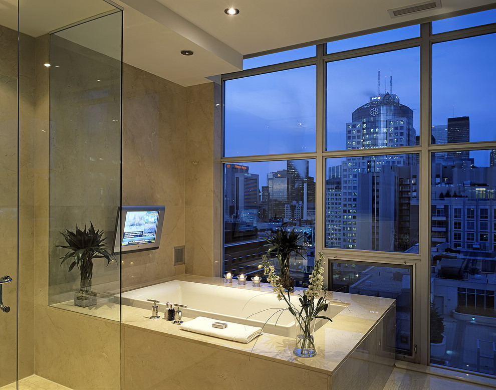 Inspiration for a contemporary beige tile bathroom remodel in Toronto