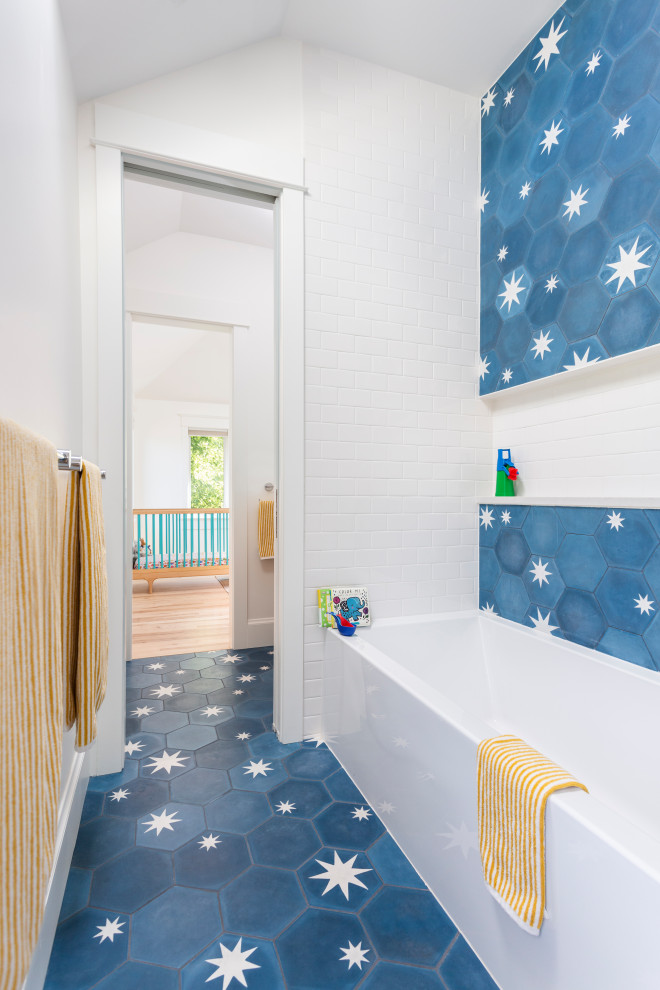Trendy blue tile and white tile blue floor alcove bathtub photo in Denver with white walls