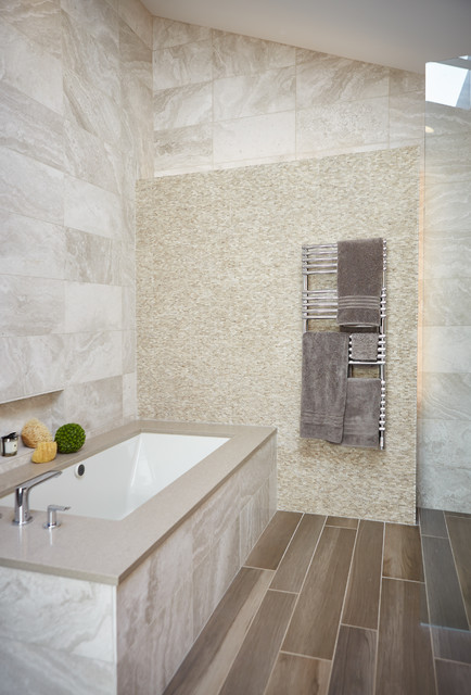 Mid-sized trendy master beige tile and white tile brown floor and vinyl floor bathroom photo in Detroit with an undermount tub and white walls
