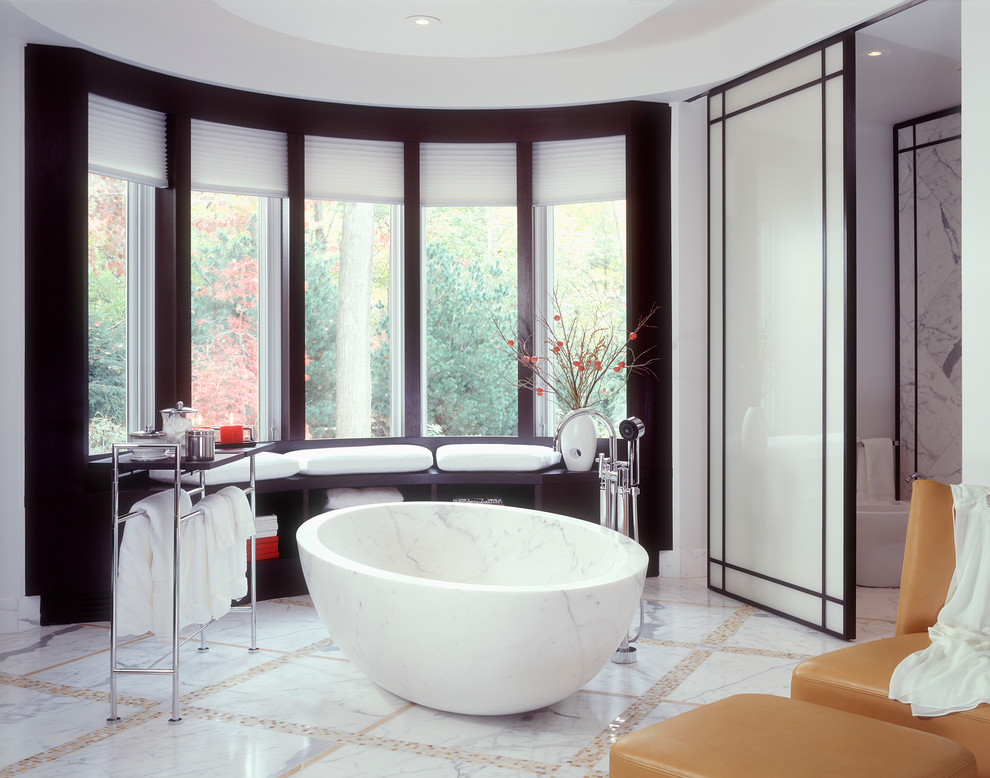 Freestanding bathtub - huge contemporary master gray tile and marble tile beige floor and marble floor freestanding bathtub idea in Cleveland with white walls, dark wood cabinets, marble countertops and an undermount sink