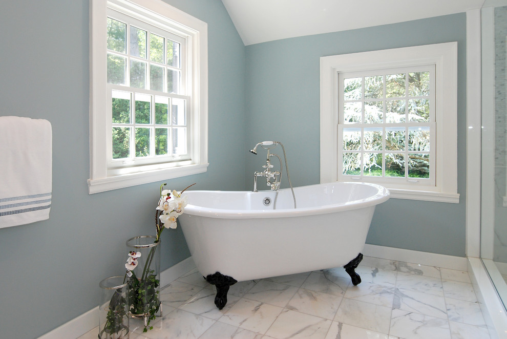 Inspiration for a contemporary claw-foot bathtub remodel in New York