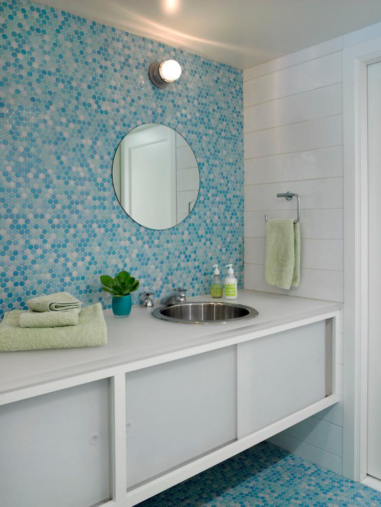 Trendy blue floor bathroom photo in New York with an undermount sink