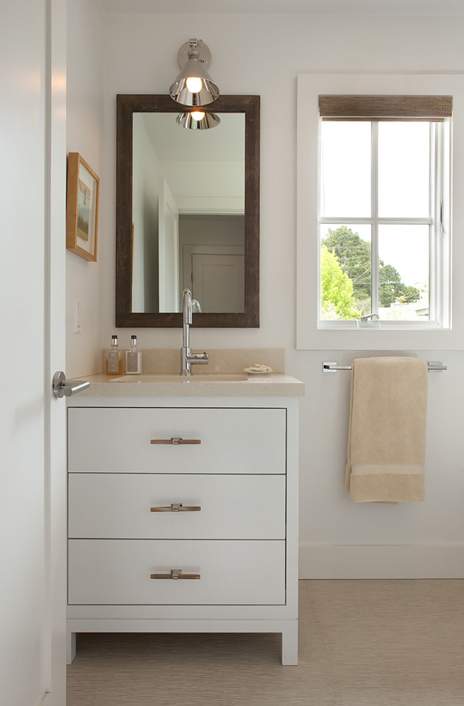 Inspiration for a contemporary bathroom remodel in San Francisco with an undermount sink, flat-panel cabinets and white cabinets