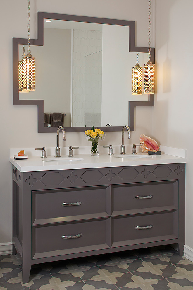 Trendy bathroom photo in San Francisco with an undermount sink, furniture-like cabinets, gray cabinets and white countertops