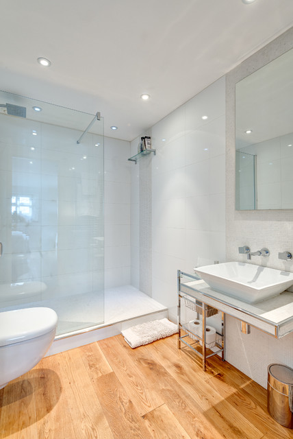 This is an example of a contemporary bathroom in Other with a vessel sink and glass tiles.