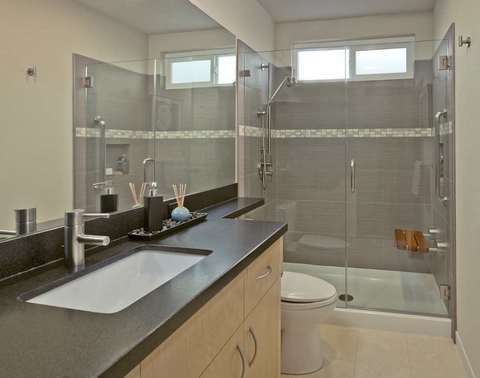 Trendy brown tile bathroom photo in San Francisco with flat-panel cabinets and light wood cabinets