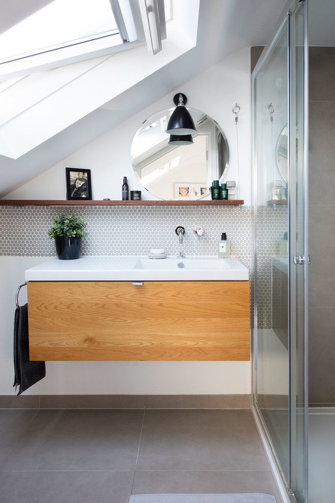 Inspiration for a contemporary 3/4 beige tile beige floor bathroom remodel in London with flat-panel cabinets, medium tone wood cabinets, multicolored walls and an integrated sink