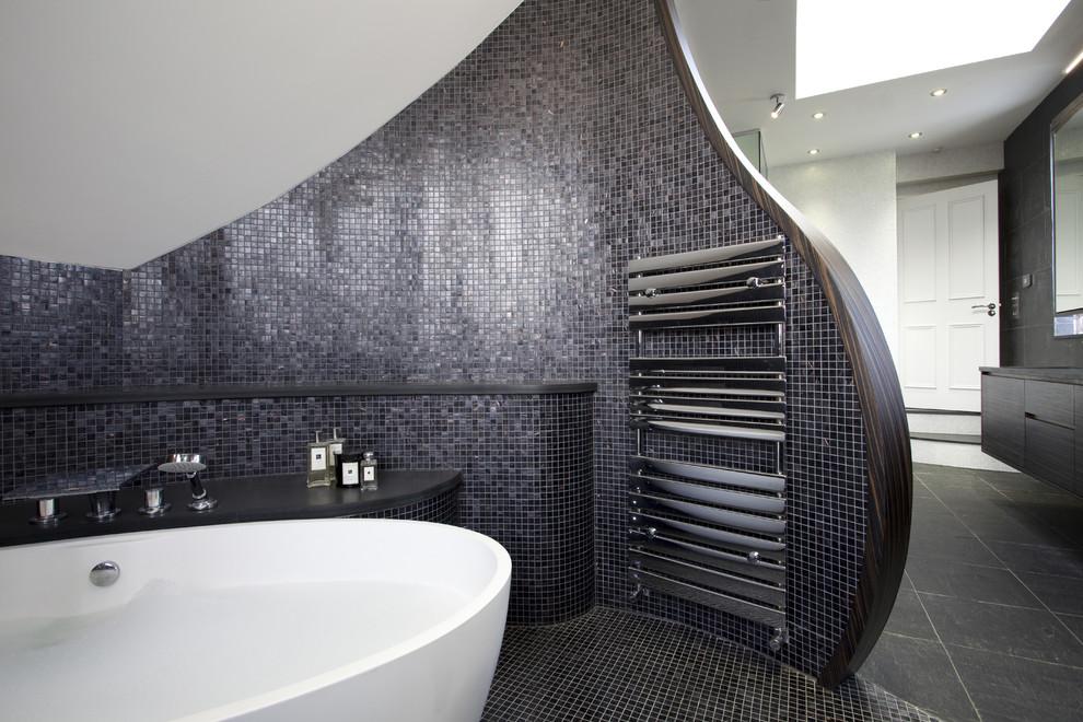 Freestanding bathtub - contemporary mosaic tile freestanding bathtub idea in London