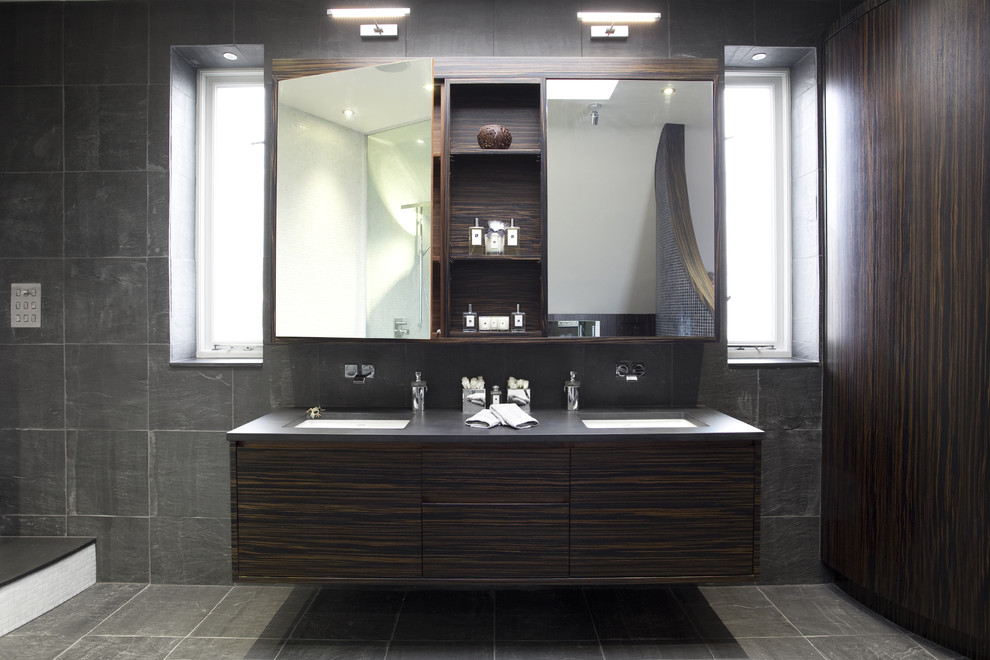 Inspiration for a contemporary bathroom in London with a freestanding bath and mosaic tiles.