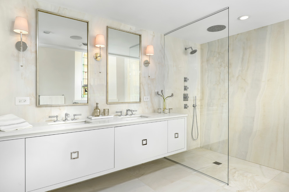 Bathroom - contemporary beige tile and stone slab beige floor bathroom idea in Chicago with an undermount sink, flat-panel cabinets and white cabinets
