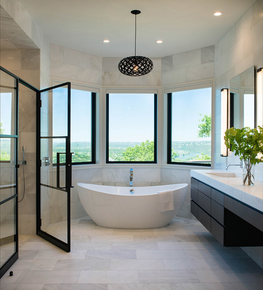 Trendy master freestanding bathtub photo in Austin with flat-panel cabinets, dark wood cabinets, an integrated sink and a hinged shower door