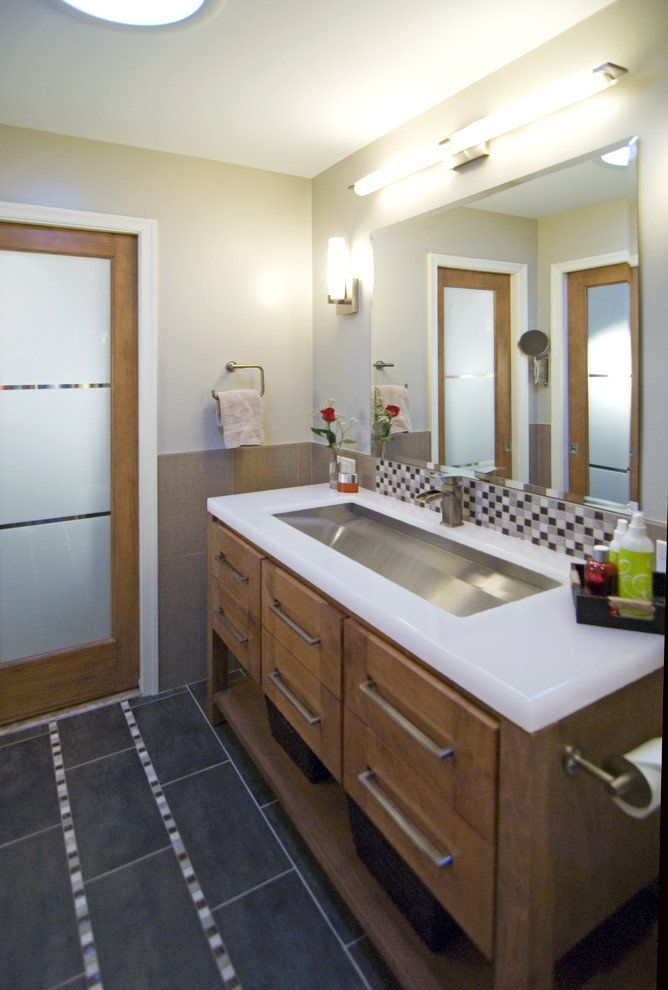 Inspiration for a contemporary bathroom remodel in DC Metro with medium tone wood cabinets
