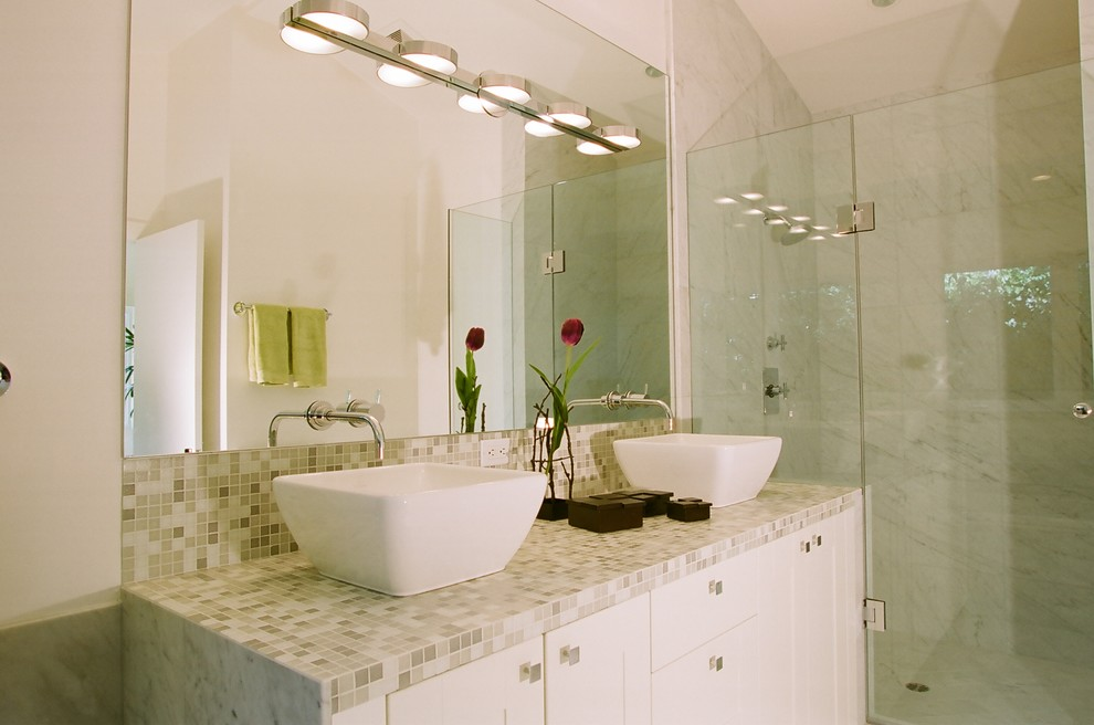 Example of a trendy mosaic tile bathroom design in Other with a vessel sink and tile countertops