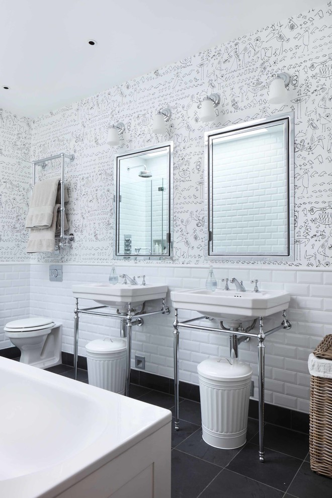Bathroom - contemporary white tile and subway tile bathroom idea in London with a console sink and a one-piece toilet