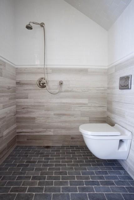 Floor To Ceiling Tile Takes Bathrooms