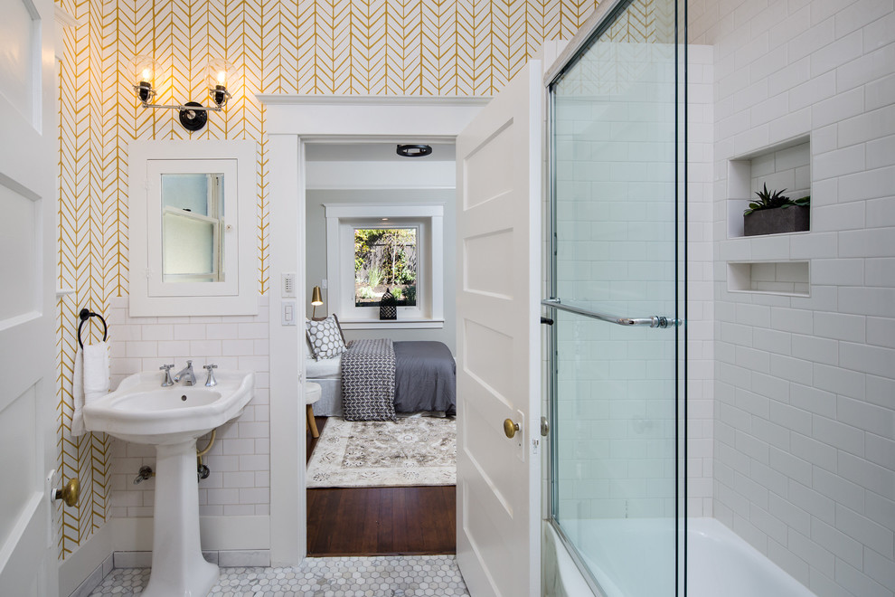 Small transitional 3/4 white tile and porcelain tile marble floor sliding shower door photo in San Francisco with white walls and a pedestal sink