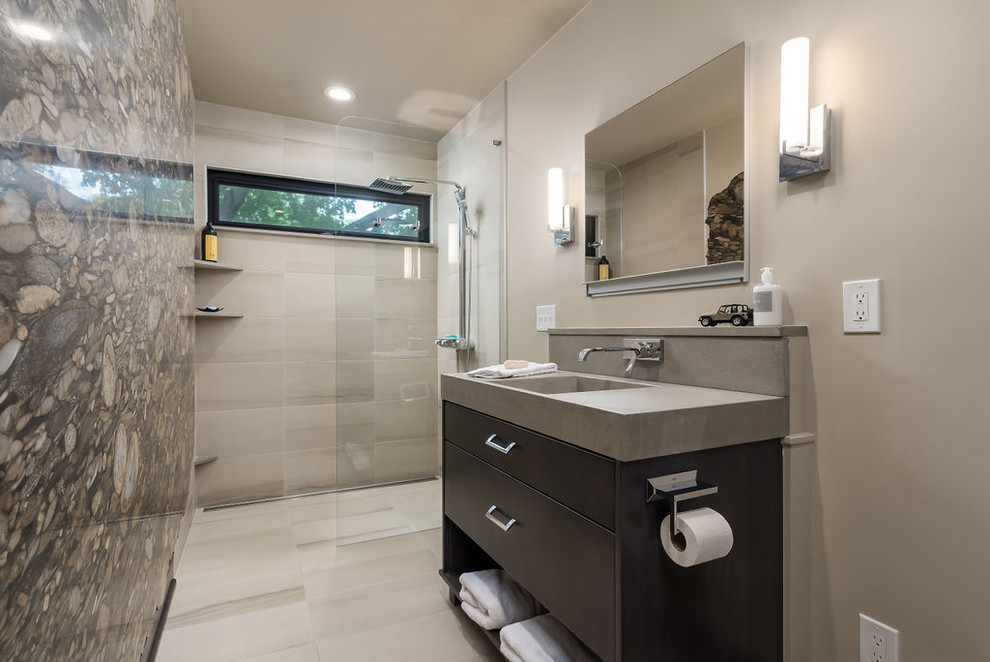 Example of a small trendy 3/4 beige tile and porcelain tile porcelain tile and beige floor bathroom design in Columbus with flat-panel cabinets, dark wood cabinets, a wall-mount toilet, beige walls, an integrated sink, concrete countertops and gray countertops