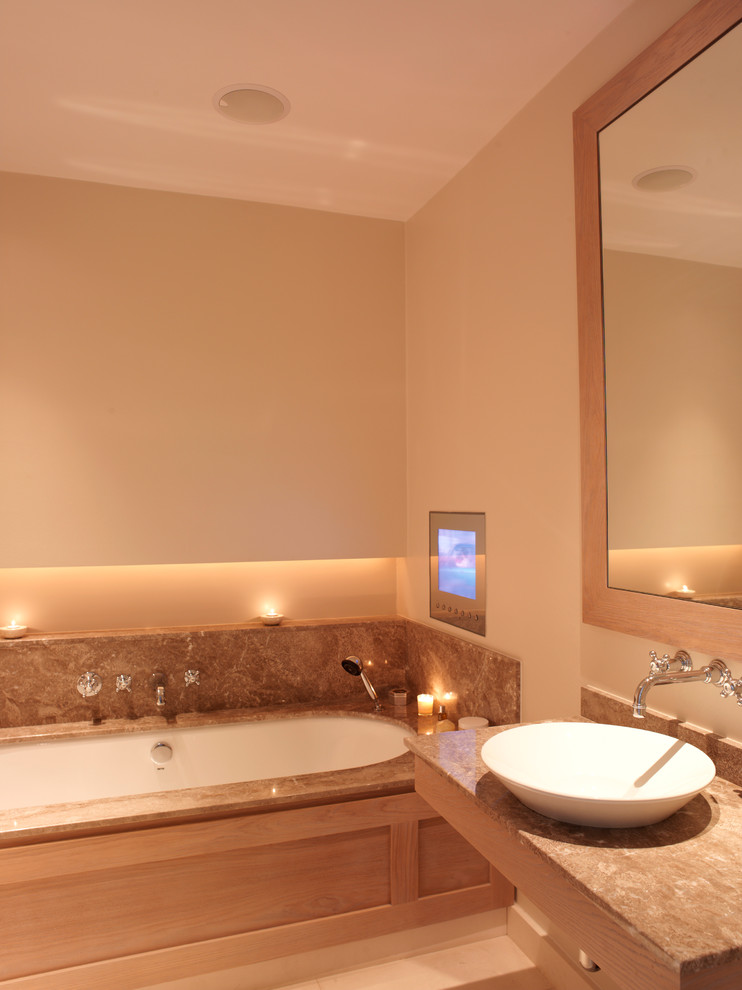 Bathroom - contemporary bathroom idea in London with granite countertops and a vessel sink