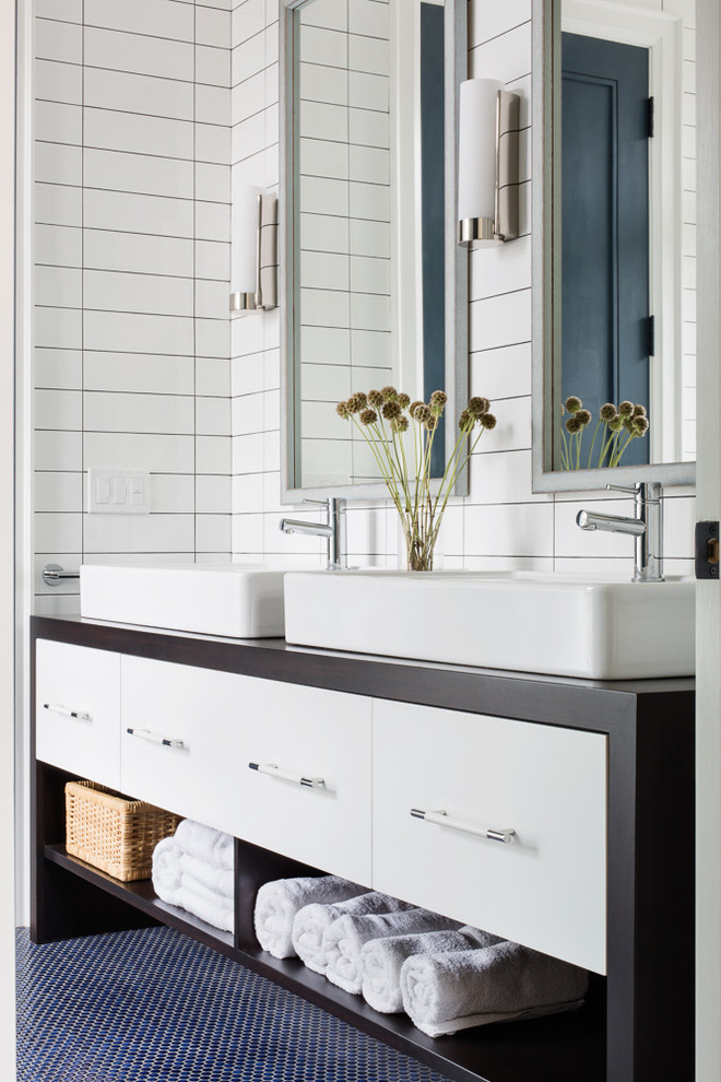 Corner shower - mid-sized contemporary white tile and ceramic tile mosaic tile floor corner shower idea in Toronto with flat-panel cabinets, white cabinets, wood countertops, a one-piece toilet, white walls, a vessel sink and brown countertops